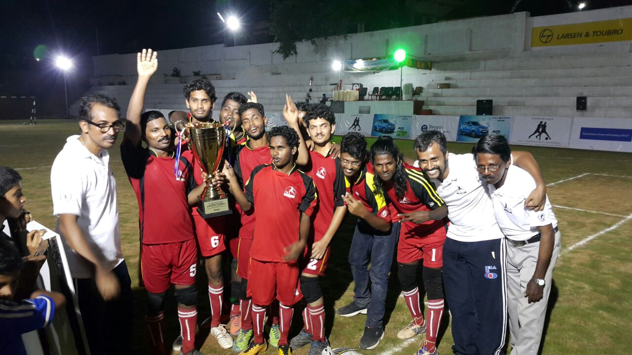 Team srvc with trophy at All India Invitational Blind Football Tournament at Aluva