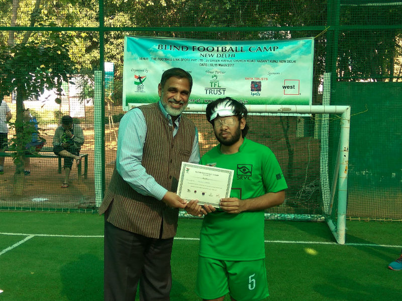 Giving certificates to players at Blind Football Demo game and Awareness session in New Delhi