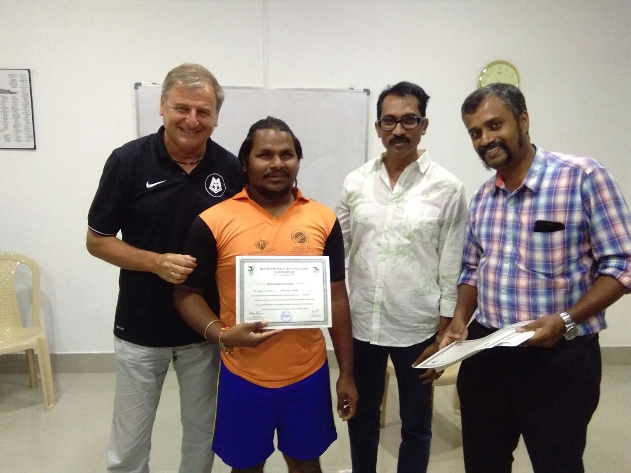 giving training certificate to students by Ulrich Pfisterer with mc roy and sunil j mathew