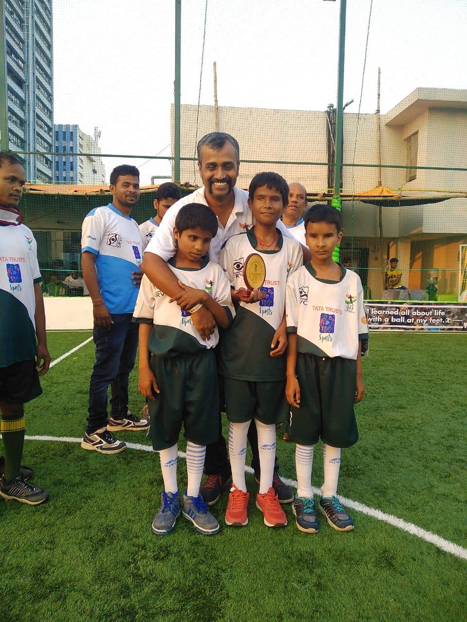 Indain team coach sunil j mathew with little footballers