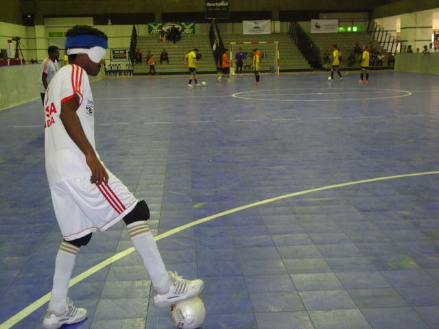 Indian player kicking ball
