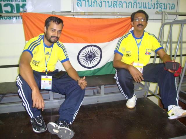 Sunil j mathew and m c roy with indian flag bangkok