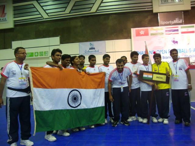 Team india with indian flag at bangkok tournament