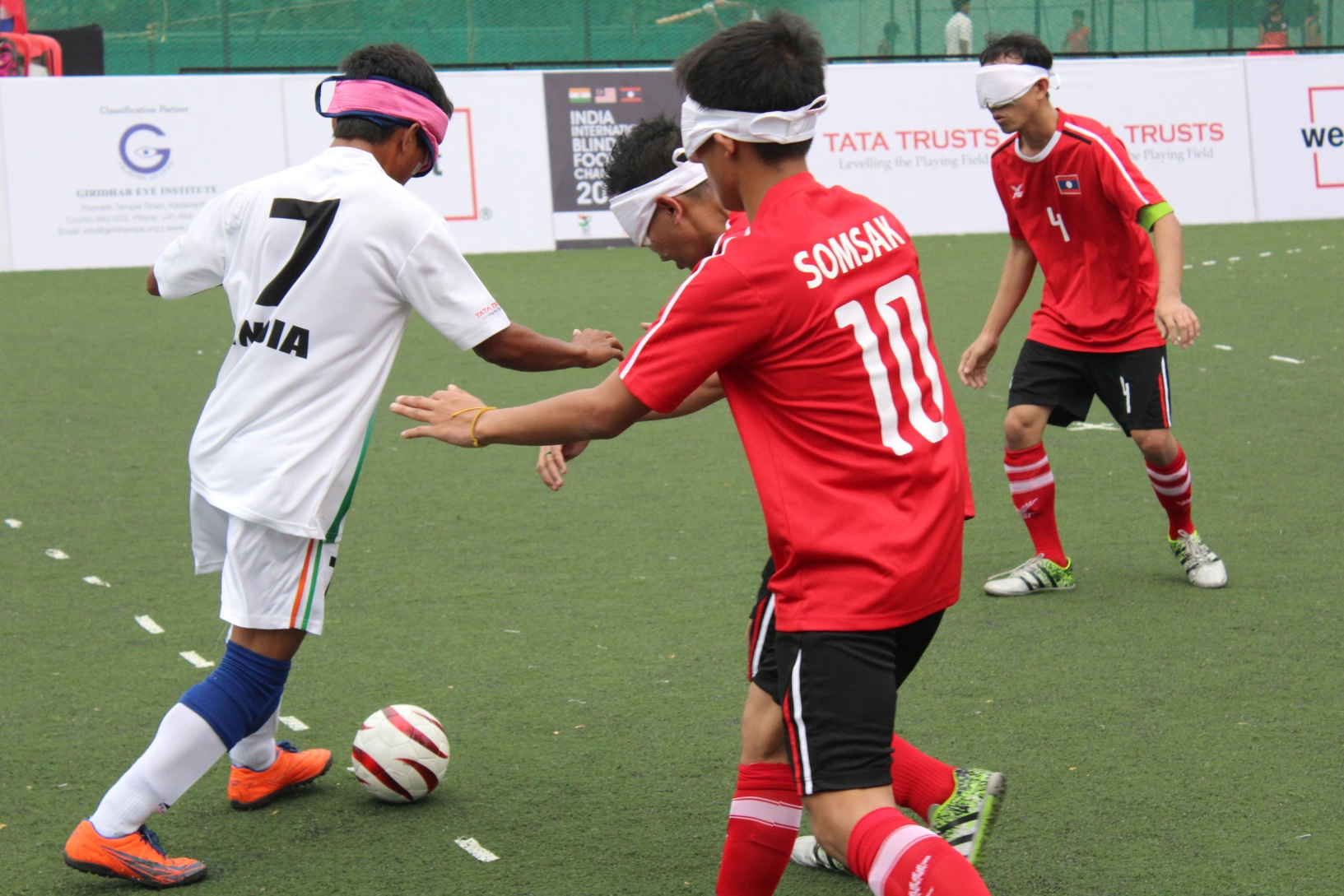 Laos players defending attack from indian player