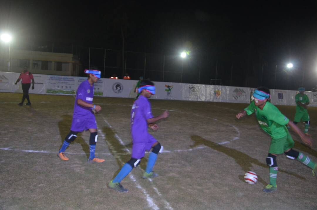 player kicking ball