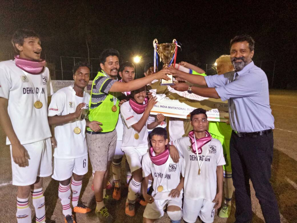 Actor Sijoy Varghese giving trophy to winners of Second All India Invitational Blind Football Tournament