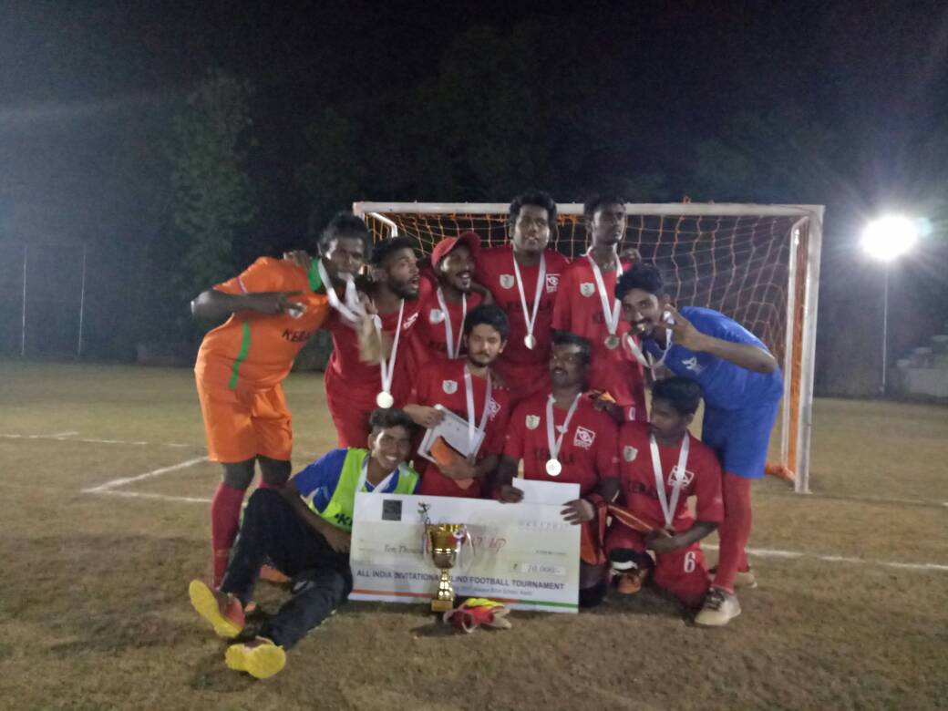 Kerala team with their trophy and cash prize